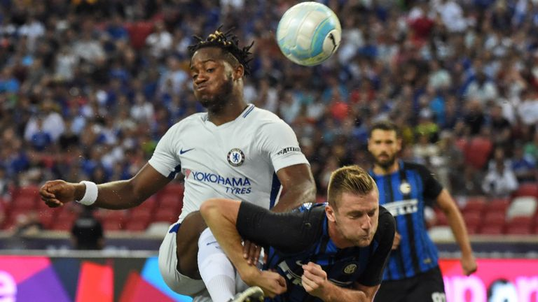 Chelsea's Michy Batshuayi (L) fights for the ball with Inter Milan's Danilo D'Ambrosio during their International Champions Cup football match in Singapore