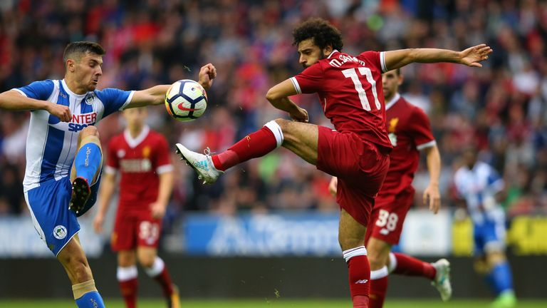 Mo Salah challenges for the ball at the DW Stadium