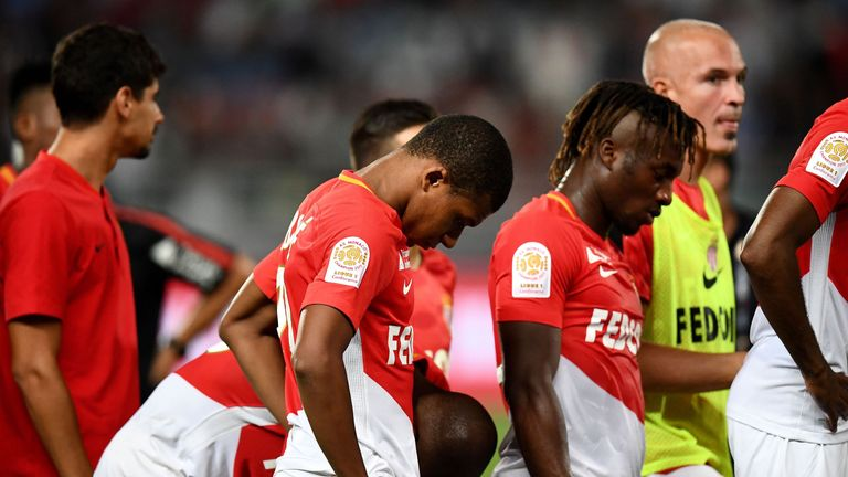 Kylian Mbappe (centre) reacts after losing the Trophee des Champions match