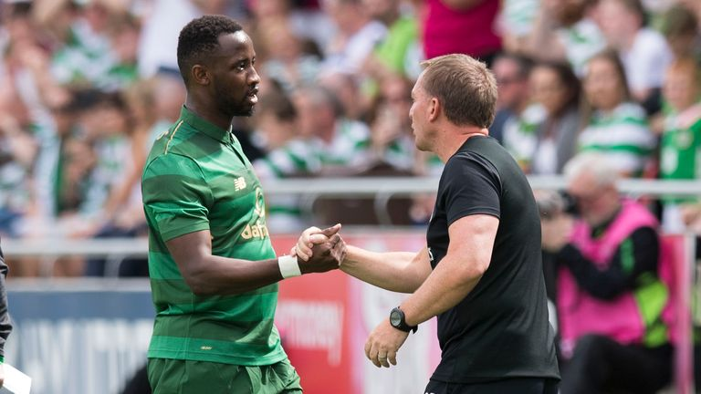 Celtic manager Brendan Rodgers (right) with Moussa Dembele as he is substituted against Shamrock Rovers