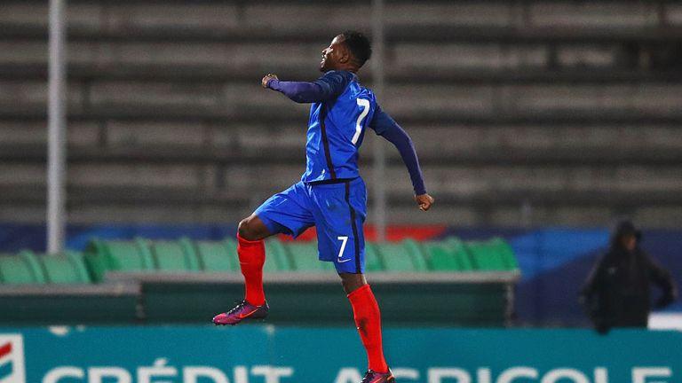 Moussa Dembele celebrates a goal for  the France U21 side