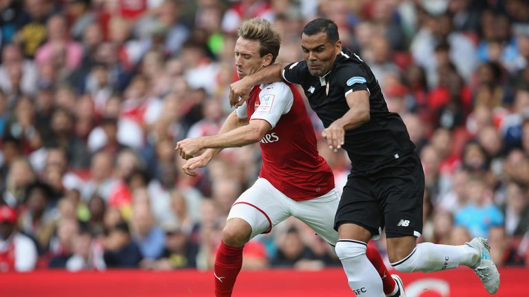 Nacho Monreal battles with Gabriel Mercado during Arsenal's 2-1 defeat