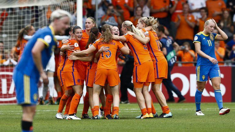 Dutch players celebrate after winning the UEFA Womens Euro 2017 football match between the Netherlands and Sweden at the De Vijverbeg stadium in Doetinchem