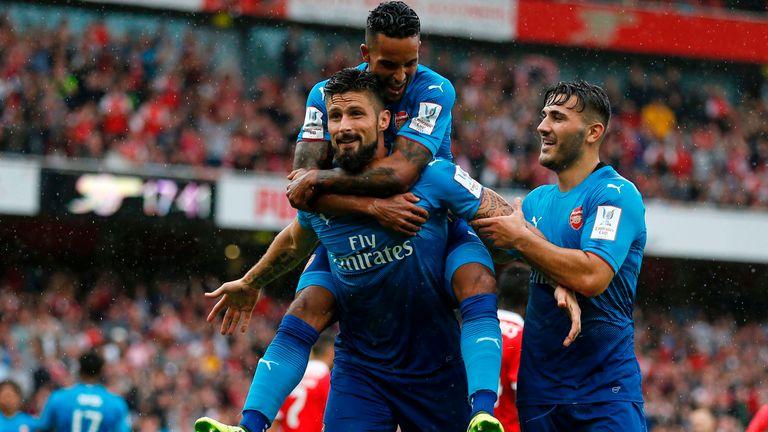 Arsenal striker Olivier Giroud celebrates with Arsenal's Theo Walcott