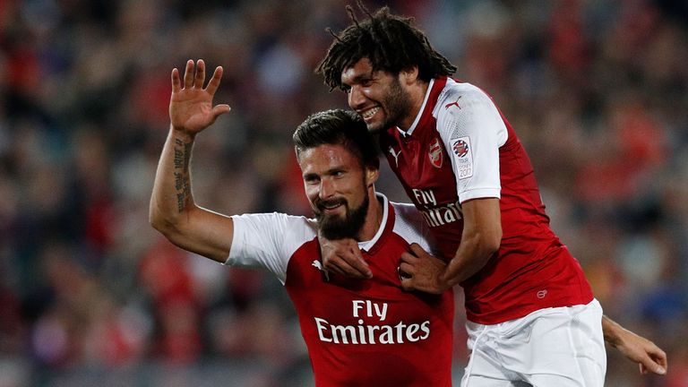 Olivier Giroud and Mohamed Elneny celebrate Arsenal's opening goal against Western Sydney Wanderers