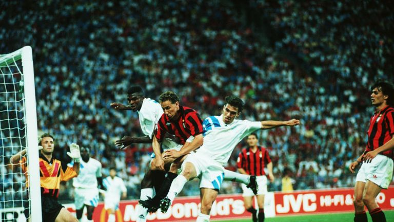 May 1993:  Jean-Pierre Papin of Milan is challenged by marcel Desailly and Jean-Christophe Thomas of Marseille during the European Cup Final played between