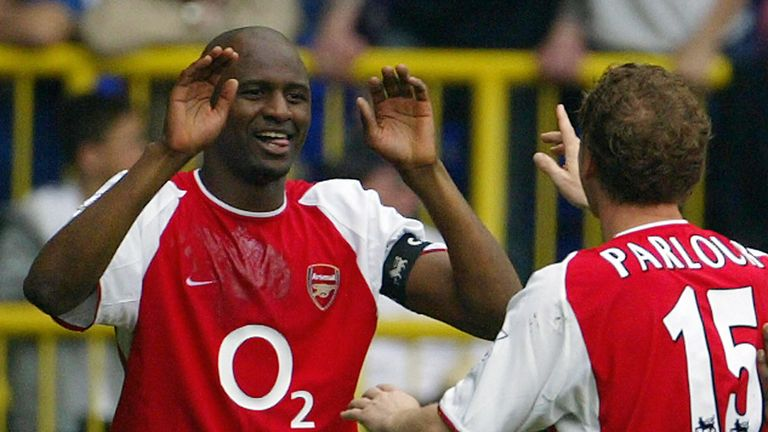 LONDON, UNITED KINGDOM:  Arsenal's French captain Patrick Vieira (L) celebrates his goal against Tottenham with teammate Ray Parlour (R) during their Premi
