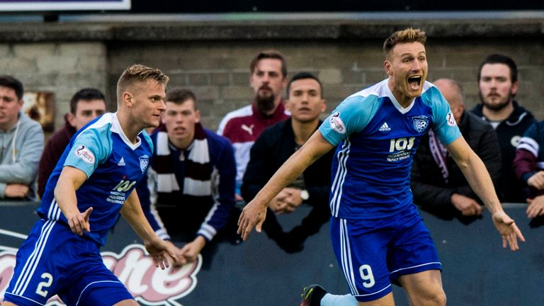 Peterhead's Jason Brown (left) celebrates putting his side ahead with Rory McAllister