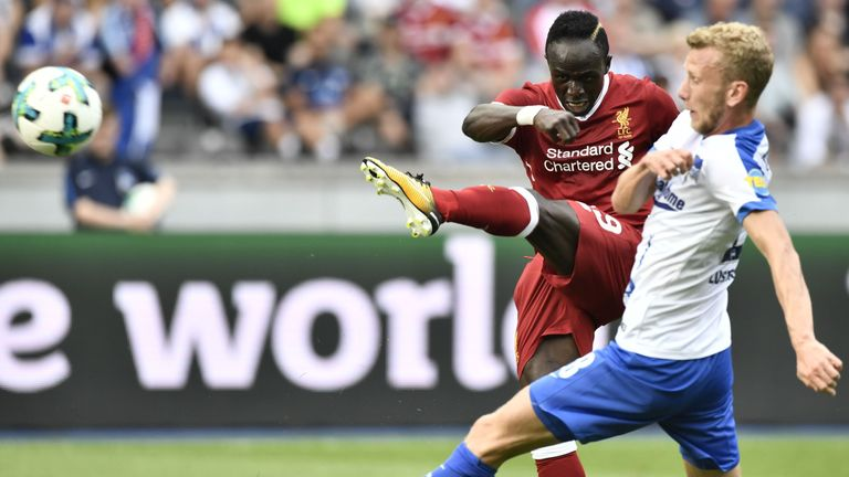 Fabian Lustenberger (R) and Sadio Mane challenge for the ball