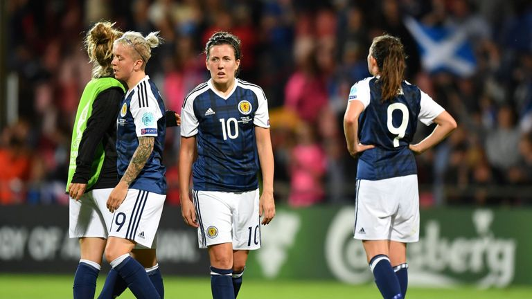 Scotland's midfielder Leanne Crichton (C) and teammates react after winning the UEFA Women's Euro 2017 football match against Spain but failing to qualify