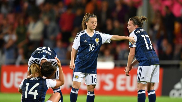 Scotland's defender Frankie Brown (R) and forward Christie Murray (C) react after winning the UEFA Women's Euro 2017 football match against Spain but faili