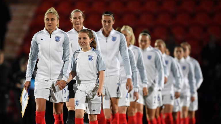 DONCASTER, ENGLAND - OCTOBER 21: Steph Houghton of England leads the team out during the International Friendly between England and France
