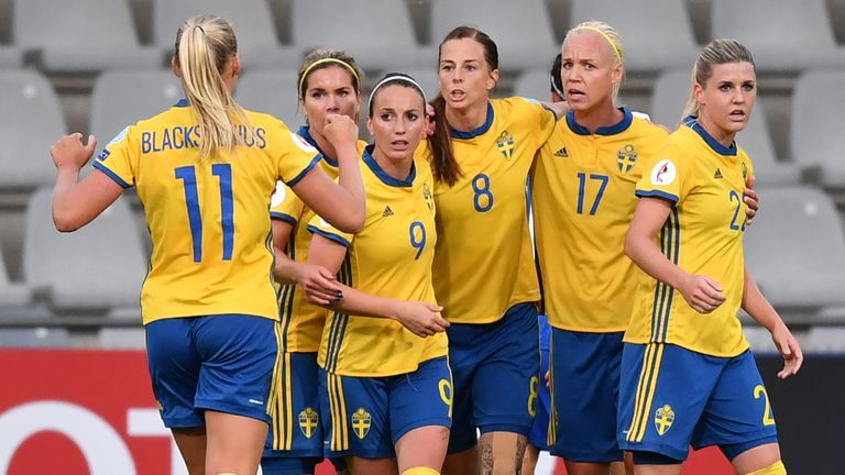 Sweden's Lotta Schelin (centre) celebrates with team-mates after scoring a penalty against Italy
