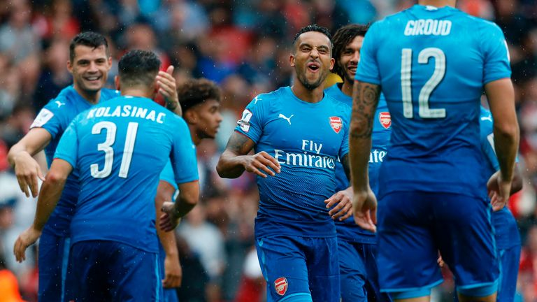 Theo Walcott celebrates with Arsenal team-mates at the Emirates