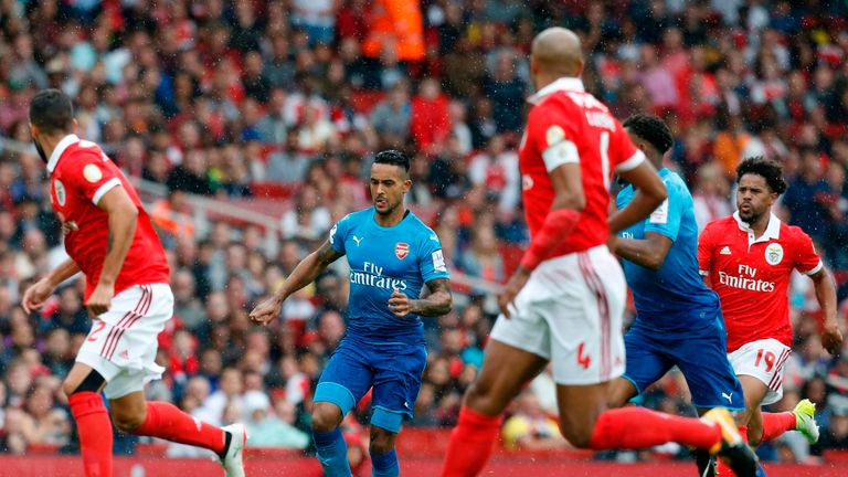 Theo Walcott scored twice as Arsenal thumped Benfica.