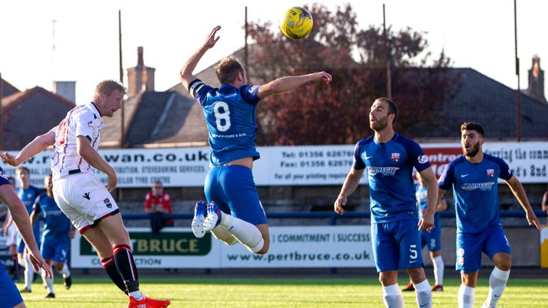 Ross County's Thomas Mikkelson heads home the opener at Links Park