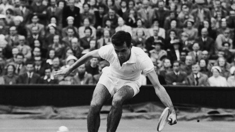 Rose in action against Tony Trabert of the U.S.A at Wimbledon in 1954