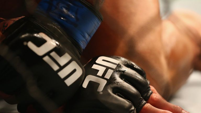 DALLAS, TX - MARCH 14:  A detail of gloves worn by Anthony Pettis and Rafael dos Anjos in the Lightweight Title bout during the UFC 185 event at American A