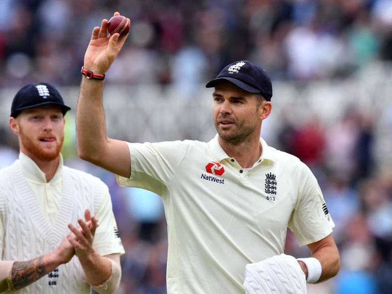 James Anderson holds up the ball after taking his fifth wicket