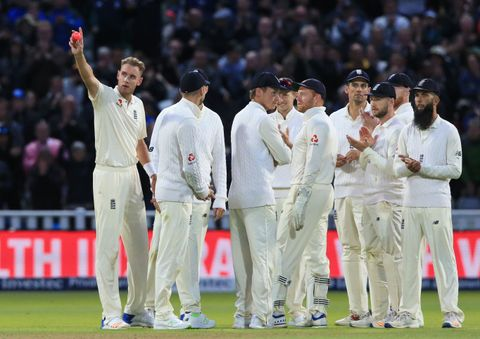 England bowler Stuart Broad (L) gestures after overtaking Ian Botham as England's second highest Test wicket-taker