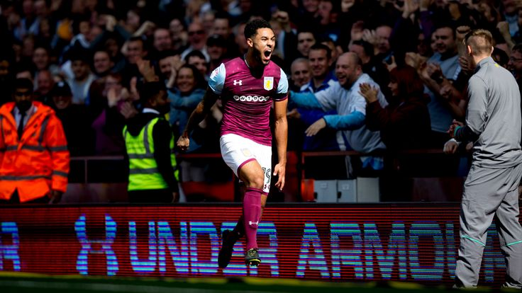 Andre Green celebrates in front of the fans after doubling Aston Villa's lead