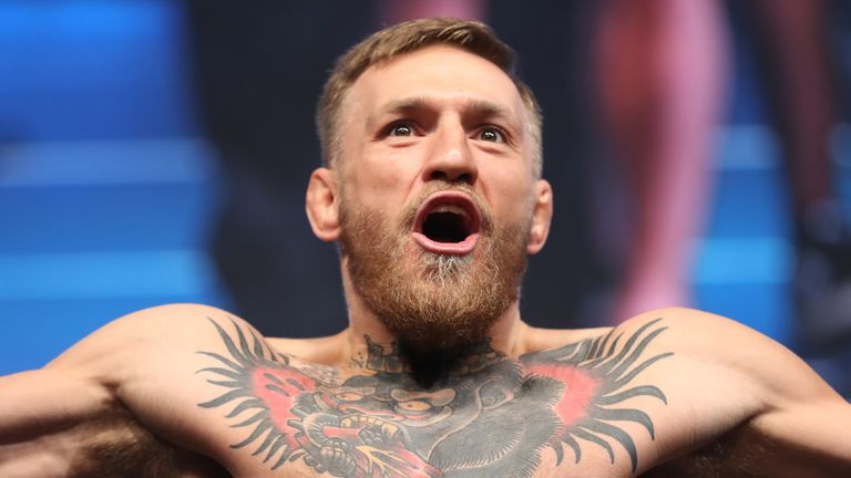 LAS VEGAS, NV - AUGUST 25:  UFC lightweight champion Conor McGregor poses on the scale during his official weigh-in at T-Mobile Arena on August 25, 2017 in