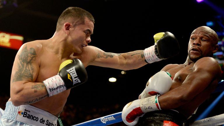 Maidana's preparation was interrupted by a glove row