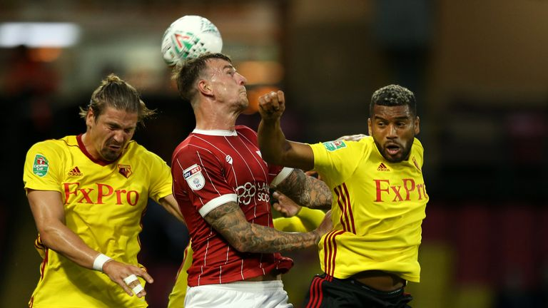 Aden Flint (C) is challenged by Sebastian Prodl and Adrian Mariappa during the Carabao Cup Second Round