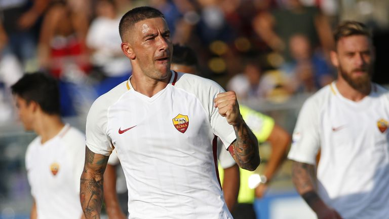 AS Roma's Serbian defender Aleksandar Kolarov (L) celebrates after scoring a goal during the Italian Serie A football matchbetween Atalanta and AS Roma on
