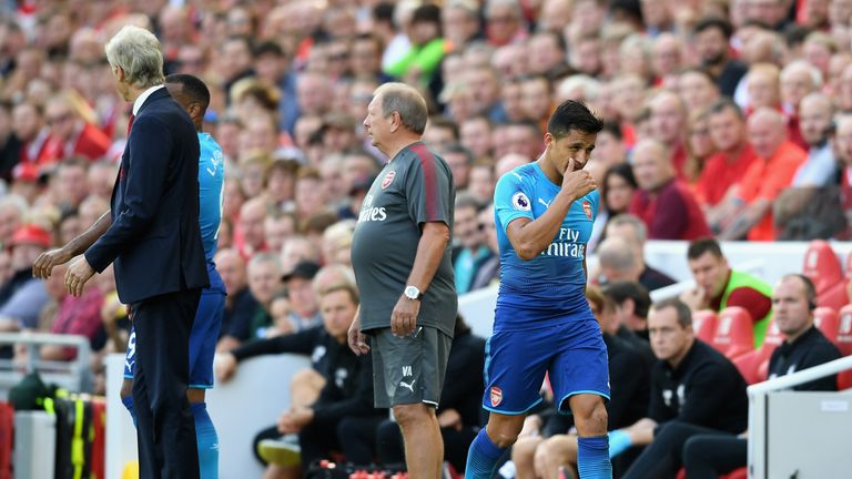 Alexis Sanchez walks off the pitch after being substituted at Anfield
