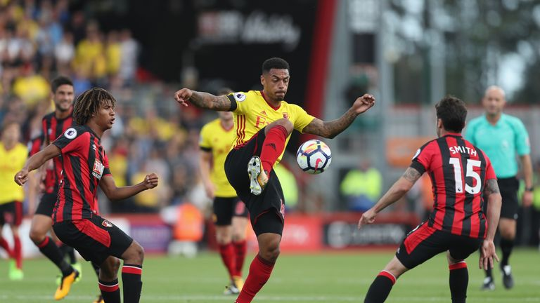 BOURNEMOUTH, ENGLAND - AUGUST 19: Andre Gray of Watford controls the ball while under pressure from Adam Smith of AFC Bournemouth during the Premier League
