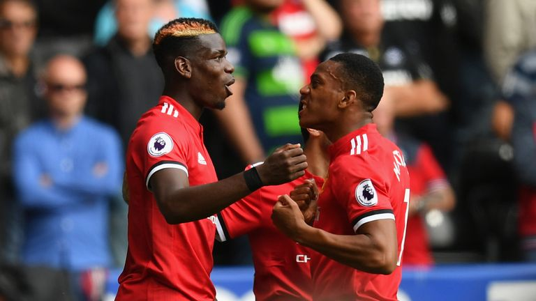 Anthony Martial of Manchester United celebrates scoring his sides fourth goal with Paul Pogba
