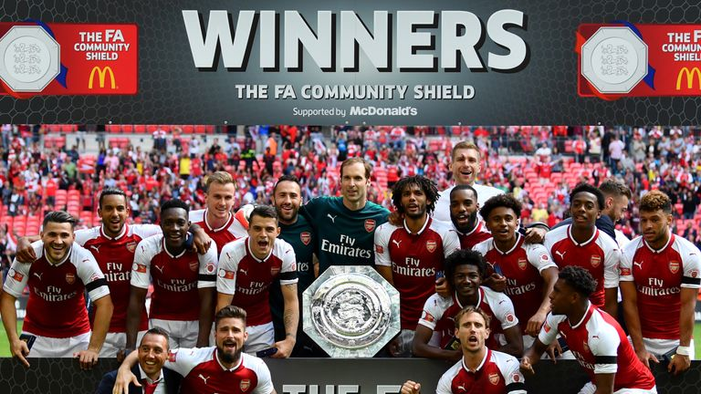 Arsenal team celebrate with the trophy following the The FA Community Shield final between Chelsea and Arsenal at Wembley Stadium