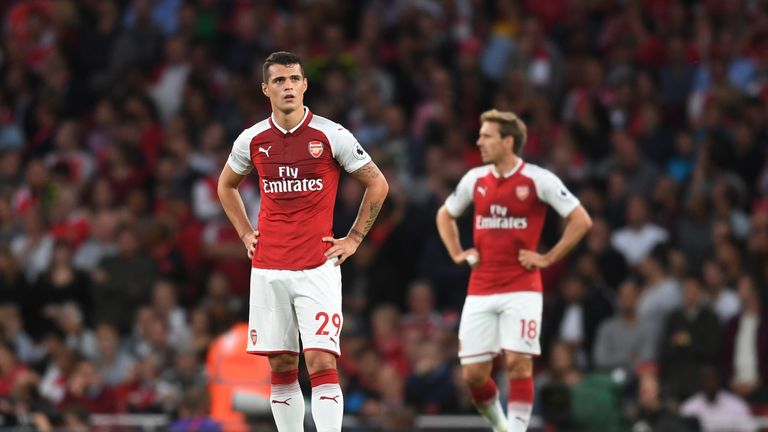 LONDON, ENGLAND - AUGUST 11:  (L-R) Granit Xhaka and Nacho Monreal of Arsenal look on after conceding a second first half goal during the Premier League ma