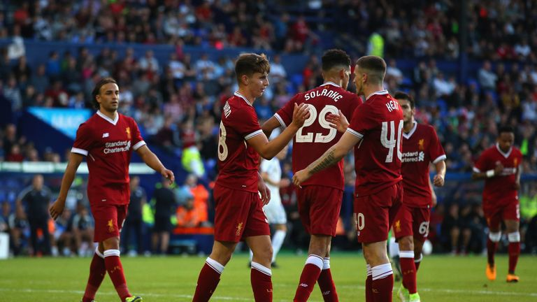 BIRKENHEAD, ENGLAND - JULY 12:  Ben Woodburn of Liverpool celebrates with Ryan Kent after scoring from the penalty spot during a pre-season friendly match
