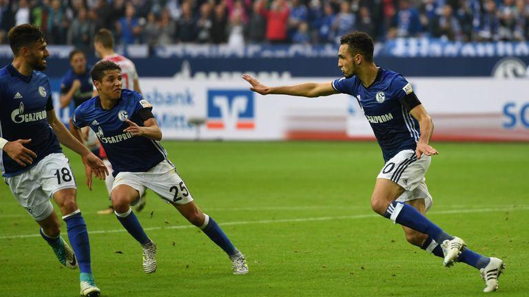 Schalke's Algerian midfielder Nabil Bentaleb (R) celebrates scoring during the German First division Bundesliga football match FC Schalke 04 vs RB Leipzig