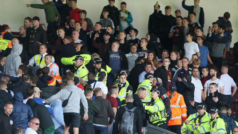 Hannover 96 and Burnley fans are separated by police in the stands during the pre-season friendly match at Turf Moor