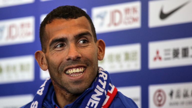 Argentine striker Carlos Tevez smiles during a press conference in Shanghai on January 21, 2017. Tevez held his first press conference for his new club Sha