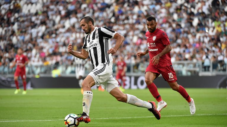 TURIN, ITALY - AUGUST 19:  Giorgio Chiellini of Juventus competes for the ball with Geraldino Joao Pedro of Cagliari Calcio during the Serie A match betwee