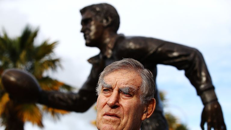 Sir Colin Meads poses in front of a statue of himself which was unveiled in Te Kuiti during the Lions' tour to New Zealand earlier this year