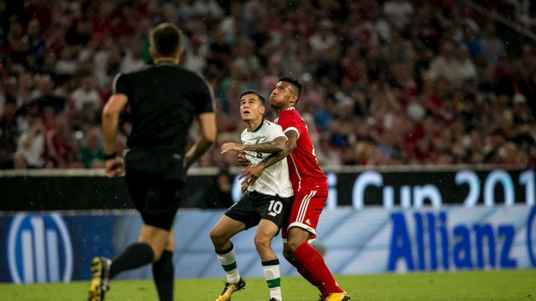 Philippe Coutinho of FC Liverpool and Corentin Tolisso of FC Bayern Muenchen  fight for the ball during the Audi Cup 2017 matc