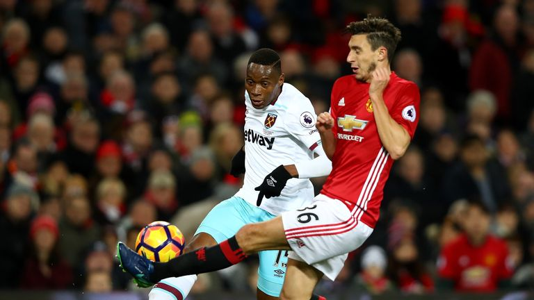 MANCHESTER, ENGLAND - NOVEMBER 27: Diafra Sakho of West Ham United (L) and Matteo Darmian of Manchester United (R) battle for possession during the Premier