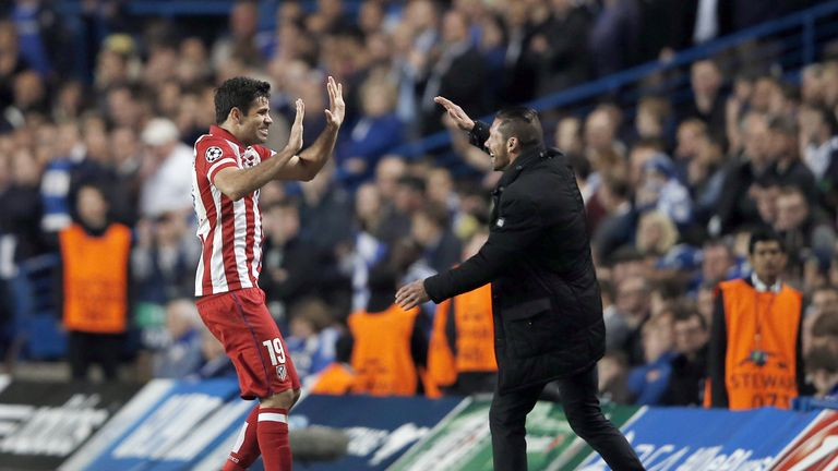 Diego Costa (L) celebrates with Atletico Madrid's coach Diego Simeone