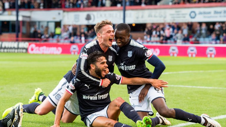 Dundee's Faissal El Bakhtaoui (seated) savours his goal in the Tayside derby