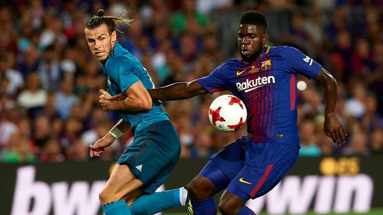 Gareth Bale challenges Samuel Umtiti in the first half of the Spanish Super Cup first leg
