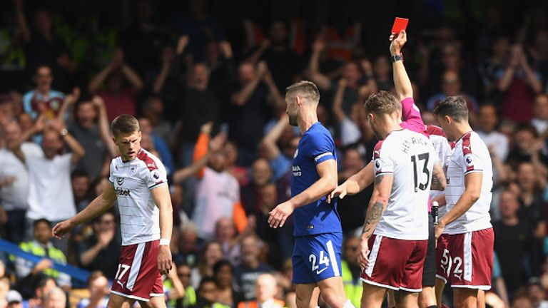 LONDON, ENGLAND - AUGUST 12:  Gary Cahill of Chelsea is sent off by referee Craig Pawson after a challenge on Steven Defour of Southampton (on floor) durin
