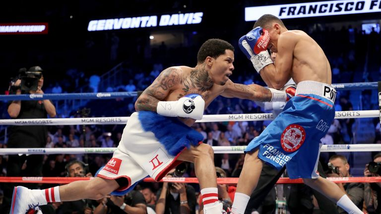 LAS VEGAS, NV - AUGUST 26:  (L-R) Gervonta Davis throws a punch at Francisco Fonseca during their junior lightweight bout on August 26, 2017 at T-Mobile Ar
