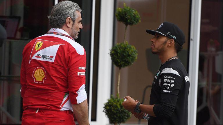 Hamilton pictured with Ferrari boss Maurizio Arrivabene at last year's Austrian GP
