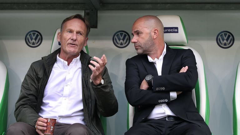 WOLFSBURG, GERMANY - AUGUST 19: Chairman Hans-Joachim Watzke (L) of Dortmund chats with head coach Peter Bosz (R) of Dortmund