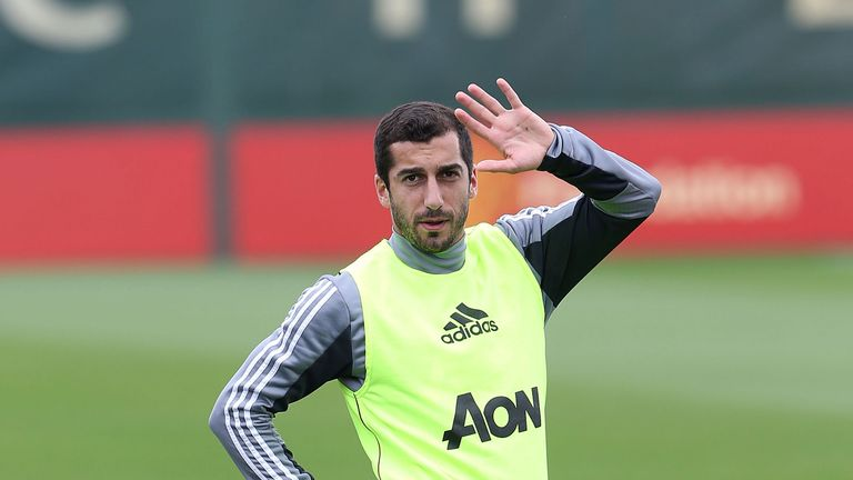 Henrikh Mkhitaryan stretches during a first team training session at the Aon Training Complex